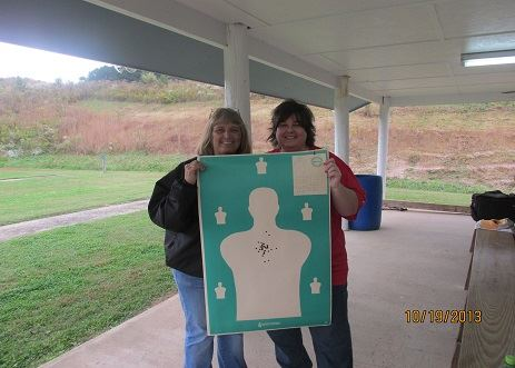 Two people at gun range